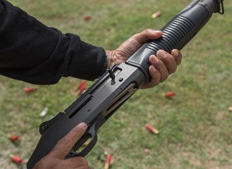 Man holds gun at foundation shotgun course in Anchorage