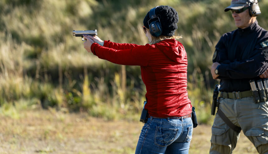 Woman attends a gun safety course with Steve McDaniel