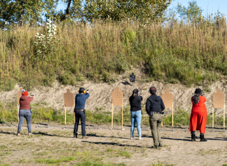 Participants practice shooting at an introductory handgun course in Anchorage.