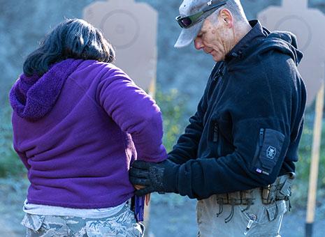 Lady draws gun at foundation handgun class in Anchorage.