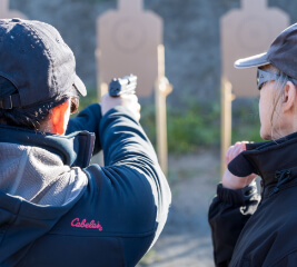 Woman learns to shoot at introductory handgun course in Anchorage.